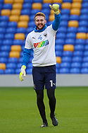 AFC Wimbledon goalkeeper Connal Trueman (1) warming up and giving thumbs up during the EFL Sky Bet League 1 match between AFC Wimbledon and Bristol Rovers at Plough Lane, London, United Kingdom on 5 December 2020.