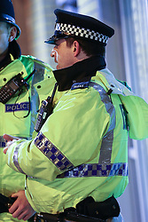 © Licensed to London News Pictures . Manchester , UK . FILE PICTURE DATED 01/01/2014 of PC KEVIN DWYER (39) , of Greater Manchester Police's North Manchester Division , on duty in Manchester City Centre . Dwyer has today (20th February 2015) pled guilty to two counts of voyeurism and ten counts of outraging public decency that took place whilst serving as a police officer . Dozens of indecent videos were found on his computer and mobile phones . Photo credit : Joel Goodman/LNP