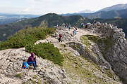 Polish hikers rest at the top of Sarnia Skala, a mountain in the Tatra National Park, on 16th September 2019, near Koscielisko, Zakopane, Malopolska, Poland.