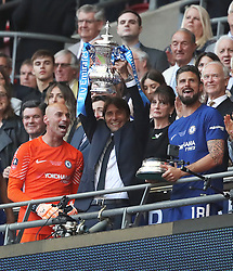 Chelsea manager Antonio Conte lifts the FA Cup trophy with his players