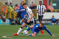 AFC Wimbledon midfielder Scott Wagstaff (7) battles for possession with Gillingham midfielder Callum Reilly (13) during the EFL Sky Bet League 1 match between AFC Wimbledon and Gillingham at the Cherry Red Records Stadium, Kingston, England on 23 March 2019.