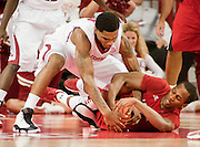Nov 15, 2013; Fayetteville, Ar, USA; Louisiana-Lafayette Ragin' Cajuns forward Elridge Moore (22) and Arkansas Razorback guard Coty Clarke (4) battle for control of the ball during the first half at Bud Walton Arena Arena.  Mandatory Credit: Beth Hall-USA TODAY Sports