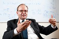 11 NOV 2010, POTSDAM/GERMANY:<br /> Prof. Ottmar Edenhofer, Deputy Director Potsdam Institute for Climate Impact Research, PIK, während einem Interview, in seinem Buero, Potsdam Institute for Climate Impact Research<br /> IMAGE: 20101111-03-031