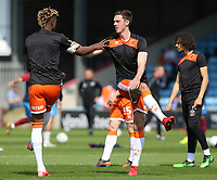 Blackpool's Ben Heneghan (right) & Armand Gnanduillet during the pre-match warm-up <br /> <br /> Photographer David Shipman/CameraSport<br /> <br /> The EFL Sky Bet League One - Scunthorpe United v Blackpool - Friday 19th April 2019 - Glanford Park - Scunthorpe<br /> <br /> World Copyright © 2019 CameraSport. All rights reserved. 43 Linden Ave. Countesthorpe. Leicester. England. LE8 5PG - Tel: +44 (0) 116 277 4147 - admin@camerasport.com - www.camerasport.com
