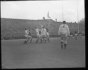 Ireland Vs England at Lansdowne Rd..1971..13.02.1971..02.13.1971..13th February 1971..In the Five Nations Championship, Ireland took on England at Lansdowne Road,Dublin. The final score in the game was Ireland 6,England 9..Bob Hiller,the England fullback,scored all his teams points with three penalties..Ireland replied with two tries from Grant and Duggan..In the championship,Wales won the Triple Crown and completed the Grand Slam when they defeated France in their final game of the season..Picture of both teams as they struggle for control of the ball.