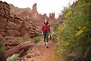 SHOT 5/7/16 10:32:30 AM - Moab is a city in Grand County, in eastern Utah, in the western United States. Moab attracts a large number of tourists every year, mostly visitors to the nearby Arches and Canyonlands National Parks. The town is a popular base for mountain bikers and motorized offload enthusiasts who ride the extensive network of trails in the area. Includes images of Scenic Byway 128, Fisher Towers and downtown Moab. (Photo by Marc Piscotty / © 2016)