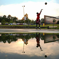 Curtis Mcmillion, 13, shoots hoops at Seabrok Park after the rain shower on Tuesday, Aug. 29, 2006.