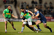 Harlequins centre Ben Tapuai breaks through Sales tacklers during a Gallagher Premiership match won by Sale Sharks 27-17 at the AJ Bell Stadium, Eccles, Greater Manchester, United Kingdom, Friday, April 5, 2019. (Steve Flynn/Image of Sport)