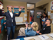 19 DECEMBER 2019 - URBANDALE, IOWA: Volunteers DAWN HALSTEAD, front left, and JEREMY JONES, front right, listen to US Senator CORY BOOKER (D-NJ) talk to volunteers at his presidential campaign headquarters in Urbandale, a suburb of Des Moines. Sen. Booker, who did not qualify for the December 19 debate in Los Angeles, campaigned in the Des Moines area Thursday and visited the phone bank at his Iowa campaign headquarters. Iowa traditionally holds the first event of the presidential election cycle. The Iowa caucuses at Feb. 3, 2020.              PHOTO BY JACK KURTZ