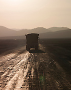 Truck on a dirt road in the Atacama desert, Chile
