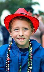 15 Feb 2015. New Orleans, Louisiana.<br /> Mardi Gras. Ben catching beads at The Krewe of Thoth.<br /> Photo; Charlie Varley/varleypix.com