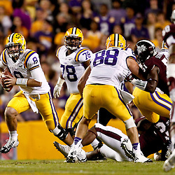 November 10, 2012; Baton Rouge, LA, USA; LSU Tigers quarterback Zach Mettenberger (8) escapes from the pocket during the first quarter of a game against the Mississippi State Bulldogs at Tiger Stadium.  Mandatory Credit: Derick E. Hingle-US PRESSWIRE