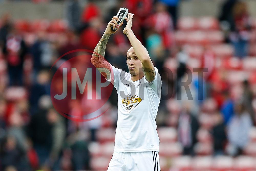 Jonjo Shelvey of Swansea City applauds the travelling fans after the game ends 1-1 - Photo mandatory by-line: Rogan Thomson/JMP - 07966 386802 - 27/08/2014 - SPORT - FOOTBALL - Sunderland, England - Stadium of Light - Sunderland v Swansea City - Barclays Premier League.