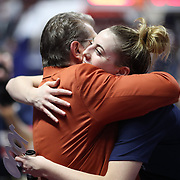 UNCASVILLE, CONNECTICUT- DECEMBER 19:  Head coach Geno Auriemma of the UConn Huskies is embraced by Katie Lou Samuelson #33 of the Connecticut Huskies after recording his 1000th win as head coach of the team during the Naismith Basketball Hall of Fame Holiday Showcase game between the UConn Huskies Vs Oklahoma Sooners, NCAA Women's Basketball game at the Mohegan Sun Arena, Uncasville, Connecticut. December 19, 2017 (Photo by Tim Clayton/Corbis via Getty Images)