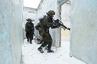 23 FEB 2013, LETZLINGEN/GERMANY:<br /> Panzergrenadier des Panzergrenadierbattalions 212 mit AGDUS, Ausbildungsgeraet Duellsimulator, und Gewehr G36, waehrend einer Gefechtsuebung im abgesessenen Kampf im Winter, Gefechtsuebungszentrum Heer, Truppenuebungsplatz Altmark<br /> IMAGE: 20130223-01-055<br /> KEYWORDS: Gefechtsübung, Schnee, Gefechtsübungszentrum, Bundeswehr, Heer, Armee, Soldat, Soldaten, Militaer, Militär, Haeuserkampf, Häuserkampf, Ortskampf, Military Operations in Urban Terrain