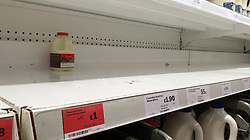 © Licensed to London News Pictures. 31/07/2021. London, UK. Empty shelves of milk in Sainsbury's, north London. The UK's biggest milk processor, Arla Foods UK, has said that about 600 individual stores out of the 2,400 that it routinely supplies missed a delivery due to the pingdemic and a lack of lorry drivers. The pingdemic has seen staff shortages at supermarkets, resulting in less stock making its way to supermarket shelves. Photo credit: Dinendra Haria/LNP