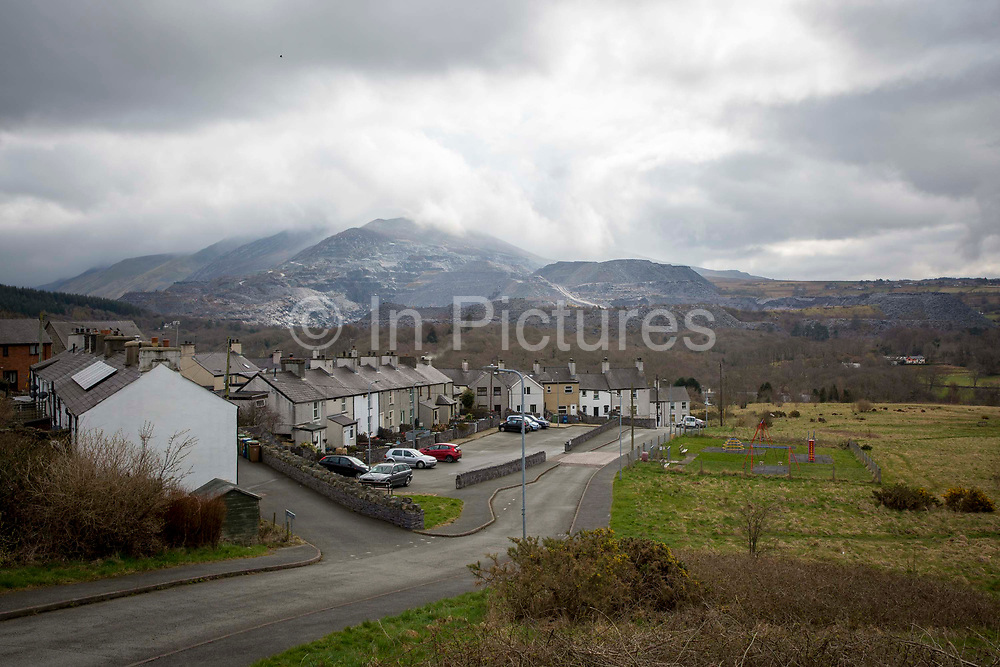The streets of Bethesda overlooked by the nearby slate quarry and Snowdonia in Gwynedd, Wales. The population of Bethesda is currently around only 4,327 according to a 2001 census.