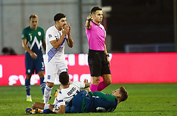 Referee Carlos del Cerro Grande (ESP) and  Dimitris Kourbelis of Greece after he faulted Andraz Sporar of Slovenia during football match between National teams of Greece and Slovenia in Final tournament of Group Stage of UEFA Nations League 2020, on November 18, 2020 in Georgios Kamaras Stadium, Athens, Greece. Photo by MATTHAIOS YORGOS / INTIME SPORTS / SPORTIDA