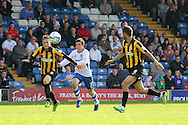 Bury's Craig Jones © breaks past Southend's Ben Coker (Southend's Goalscorer) and Luke Prosser. Skybet football league two match, Bury v Southend Utd at Gigg Lane in Bury, England on Sat 21st Sept 2013. pic by David Richards/Andrew Orchard sports photography