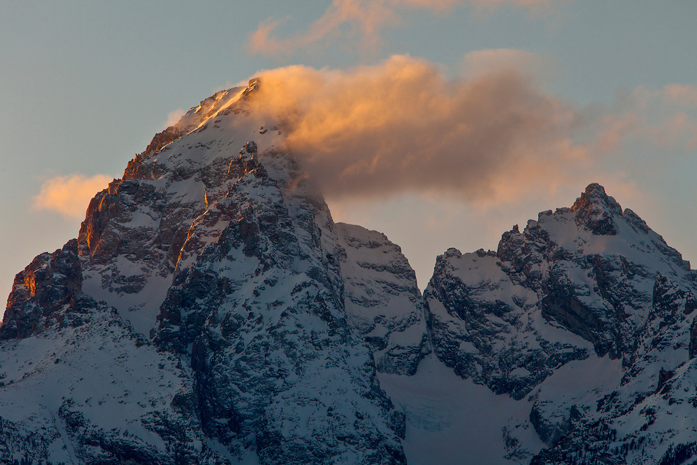 """The Teton Range at sunset is a mountain range of the Rocky Mountains in North America. A north-south range, it is on the Wyoming side of the state's border with Idaho, just south of Yellowstone National Park. Most of the range is in Grand Teton National Park.<br /> <br /> Early French Voyageurs used the name """"les Trois Tétons"""" (the three breasts).[1] It is likely that the Shoshone people once called the whole range Teewinot, meaning """"many pinnacles"""".[2]<br /> <br /> The principal summits of the central massif, sometimes referred to as the Cathedral Group, are Grand Teton (13,770 feet (4,200 m)), Mount Owen (12,928 feet (3,940 m)), Teewinot (12,325 feet (3,757 m)), Middle Teton (12,804 feet (3,903 m)) and South Teton (12,514 feet (3,814 m)). Other peaks in the range include Mount Moran (12,605 feet (3,842 m)), Mount Wister (11,490 feet (3,500 m)), Buck Mountain (11,938 feet (3,639 m)) and Static Peak (11,303 feet (3,445 m))."""