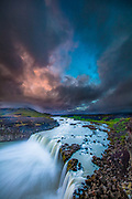 Þjófafoss (Thjofafoss) is located on the river Þjórsá on the east side of the Merkurhraun lava fields in the south of Iceland, at the southwest tip of the hill Búrfell. The waterfall Þjófafoss is part of the Þjórsá river that stretches from the Icelandic Highland all the way to the south shore in the Southern Region in Iceland.  It is the longest river in Iceland 230 kilometers from Bergvatnskvísl the northernmost source at Srengisandur.  According to folklore and history, the waterfall got its name from practice in the old judiciary system in Iceland, as thieves were thrown into the waterfall to finish their sentence. Almost without exception, none have ever been seen again. The waterfall is south of the beautiful mountain Búrfell.