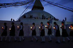 April 25, 2017 - Kathmandu, Nepal - Nepalese school students hold candles taking rounds around the Boudhanath Stupa in remembrance and memory of those lives lost to mark the 2nd anniversary of the 2015 Nepal Earthquake in Kathmandu, Nepal on Tuesday, April 25, 2017. (Credit Image: © Skanda Gautam via ZUMA Wire)