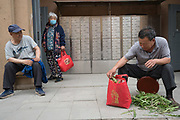 Residents of the apartment blocks with vegetables<br /><br />Huge construction and recently built tower blocks in Tongzhou city on the outskirts of Beijing. All the old buildings, villages have been destroyed to make way for the mega cities of today