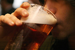 Embargoes to 0001 Monday November 19 File photo dated 01/12/06 of a man drinking a pint of beer. A new study suggests people living in cold climates with less sunlight are more likely to drink heavily.