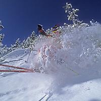 Sinuhe Xavier Schrechengost (MR) skis through deep powder snow on The Ridge at Bridger Bowl, near Bozeman, Montana.