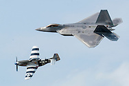 New Windsor, New York - A U.S. Air Force F-22 Raptor and a World War II P-51D Mustang fly on the USAF Heritage Flight at the New York Air Show at Stewart International Airport on Aug. 29, 2015.