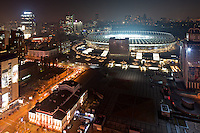 Kyiv at night shows Opereta Theatre on the foreground and stadium Olympiysky on the day of soccer play.