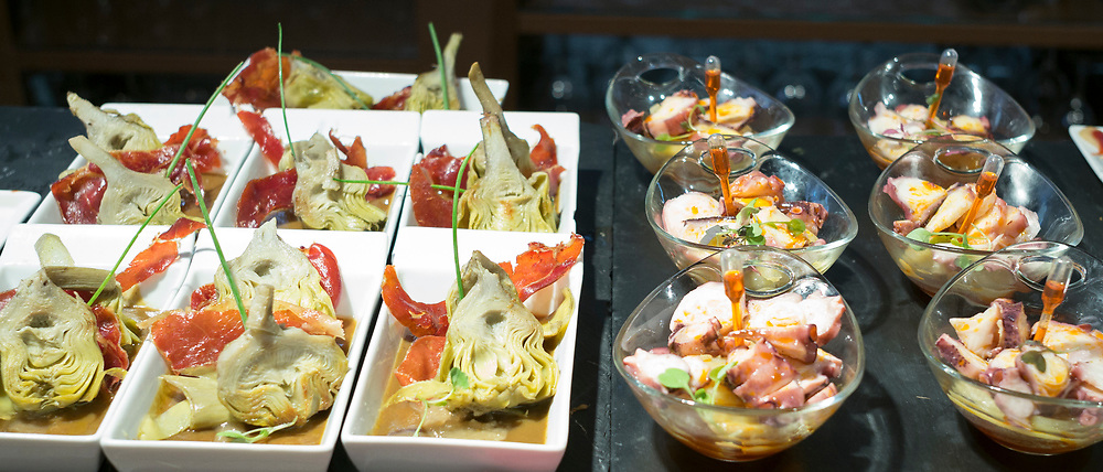 Spanish tapas, pintxos, artichokes, red pepper, seafood in tapas bar restaurant, Logrono, Basque Country, Spain