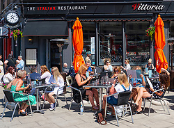 Edinburgh, Scotland, UK. 1 July  2021. Warm temperatures and sunshine attracted many members of the public to Edinburgh's outdoor cafes and bars and to the new St James Quarter shopping mall which opened last week. Pic; Vittoria Italian restaurant on Leith Walk was busy at lunchtime. Iain Masterton/Alamy Live News
