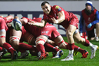 Rugby Union  - 2017 / 2018 European Champions Cup Pool 5. Llanelli Scarlets vs Bath<br /> <br /> Gareth Davies  of Llanelli Scarlets  passes the ball out,in heavy rain  at Parc Y Scarlets.<br /> <br /> COLORSPORT/WINSTON BYNORTH