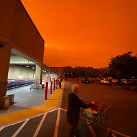 The sky above the parking lot of Costco in Santa Cruz is a stunningly abnormal shade of orange mid-afternoon on Wednesday as smoke from wildfires elsewhere in California and in Oregon filled the upper atmosphere. Much of the smoke, which was coming in from the rapidly growing Bear Fire near Chico and Creek Fire near Shaver Lake, remained at high altitude instead of settling near the surface by high winds and a strong marine layer. Social media feeds throughout Santa Cruz County and the San Francisco Bay area were filled with images and comments depicting an apocalyptic feeling created by the phenomena. (Shmuel Thaler – Santa Cruz Sentinel)