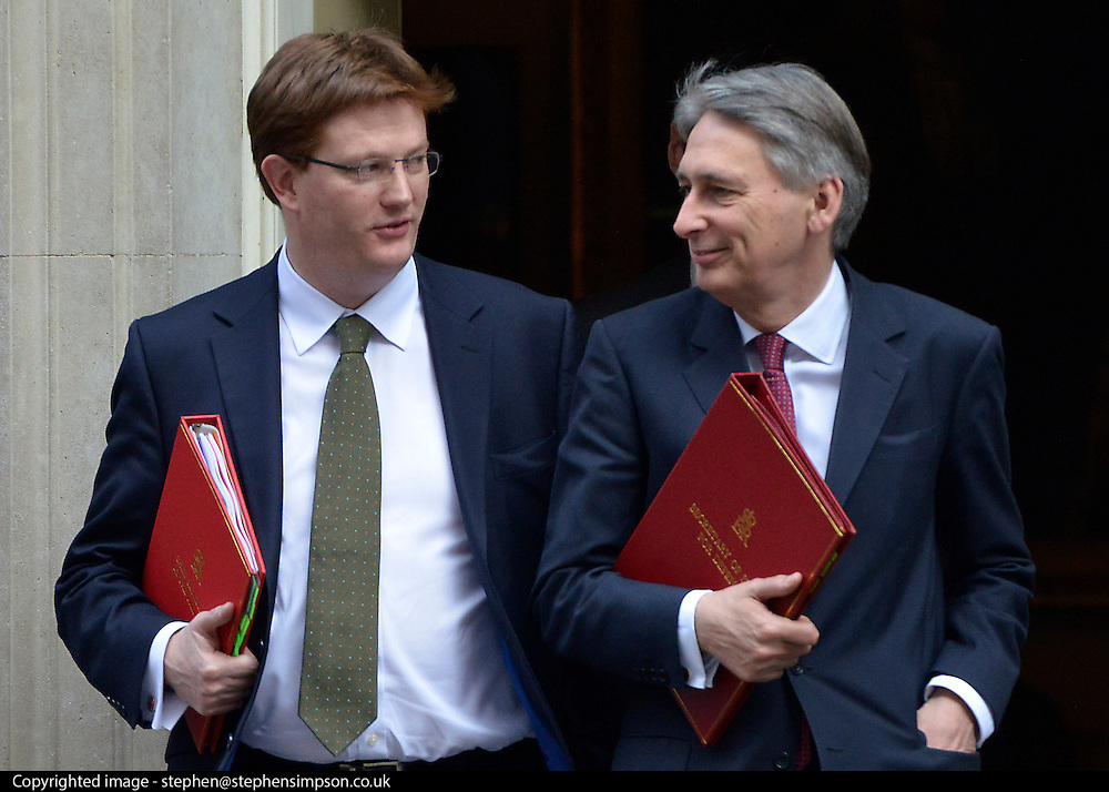 © Licensed to London News Pictures. 05/03/2013. Westminster, UK Defence Secretary.Philip Hammond (right) and Treasury Secretary.Danny Alexander leave number 10. Ministers after a Cabinet Meeting at number 10 Downing Street on 5th March 2013. Photo credit : Stephen Simpson/LNP