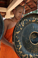 Wat Siphoutthabat, Banging a Gong -   Buddhism  in Laos is a unique version of Theravada Buddhism and is at the very basis of Lao culture. Buddhism in Laos is often closely tied to animist beliefs and belief in ancestral spirits, particularly in rural areas.