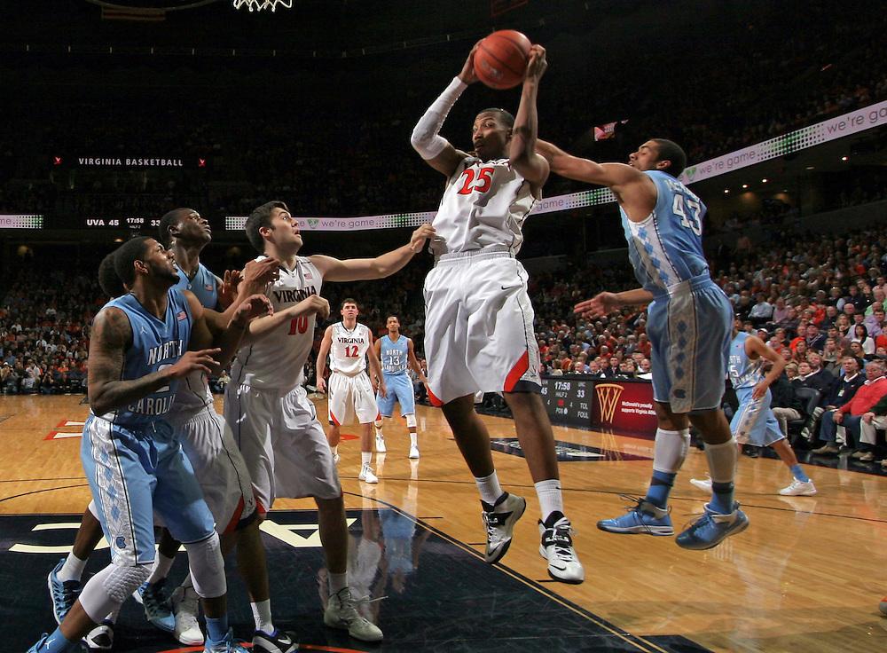 Virginia forward Akil Mitchell (25) grabs the rebound during an NCAA basketball game against Virginia Monday Jan. 20, 2014 in Charlottesville, VA. Virginia defeated North Carolina 76-61.