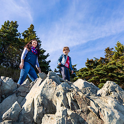 A woman and her daughter explore a cove in Quoddy Head State Park in Lubec, Maine.