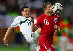 Andraz Kirm of Slovenia vs James Milner of England during the 2010 FIFA World Cup South Africa Group C Third Round match between Slovenia and England on June 23, 2010 at Nelson Mandela Bay Stadium, Port Elizabeth, South Africa.  (Photo by Vid Ponikvar / Sportida)
