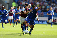 Scott Hogan of Aston Villa holds off the challenge from Lee Peltier of Cardiff city ®. EFL Skybet championship match, Cardiff city v Aston Villa at the Cardiff City Stadium in Cardiff, South Wales on Saturday 12th August 2017.<br /> pic by Andrew Orchard, Andrew Orchard sports photography.