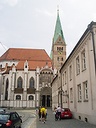 Walking along Frauentorstrasse, Augsburg, Bavaria, Germany, with a view of the Dome of St. Maria's Church.