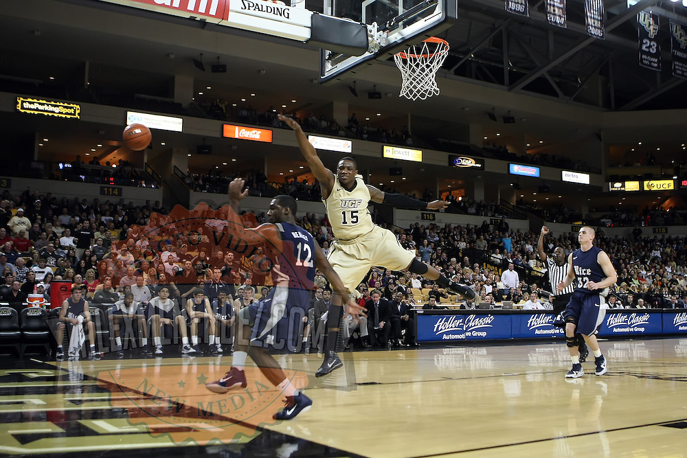 Bryan Beasley (12) and Central Florida forward David Diakite (15) reach for the ball during a Conference USA NCAA basketball game between the Rice Owls and the Central Florida Knights at the UCF Arena on January 22, 2011 in Orlando, Florida. Rice won the game 57-50 and extended the Knights losing streak to 4 games.  (AP Photo/Alex Menendez)