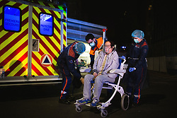 The patient is on oxygen bottle with a respirator in a wheel chair for transportation to the hospital. Orane and Nicolas, members of the Protection Civile wearing personal protection equipment (PPE) in Paris takes care of a asian women suspected of being infected by the coronavirus during an intervention. French first aid workers from the Protection Civile Paris Nicolas, Orane and Quentin takes care of Covid cases at their home as they are doing a guard by night to help the SAMU, They handle cases suspected being infected with the novel coronavirus at their home. Paris on April 19, 2020 during a lockdown in France to stop the spread of the COVID-19. France has been on lockdown since March 17 in a bid to limit the contagion caused by the novel coronavirus. Photo by Raphael Lafargue/ABACAPRESS.COM