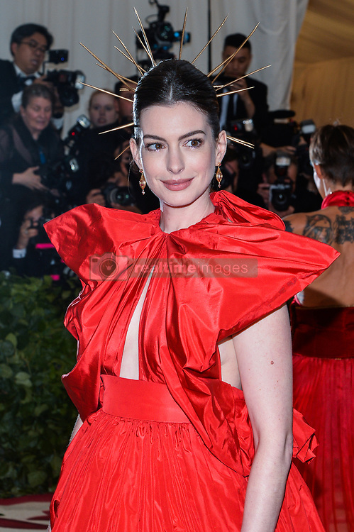 Anne Hathaway walking the red carpet at The Metropolitan Museum of Art Costume Institute Benefit celebrating the opening of Heavenly Bodies : Fashion and the Catholic Imagination held at The Metropolitan Museum of Art  in New York, NY, on May 7, 2018. (Photo by Anthony Behar/Sipa USA)