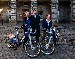 City Chambers, Edinburgh, Scotland, United Kingdom, Just Eat E-bikes: A new fleet of 163 rentable e-bikes are launched and integrated into the capital's existing cycle hire scheme by Just Eat Cycles. Edinburgh will now have the largest docked e-bike fleet in UK. Pictured: Ellie Grebenik, Energy Saving trust, George Lowder, Chief Executive of Transport for Edinburgh and Katherine Soane, Senior Project Officer, TfE Cycle Hire.<br /> Sally Anderson | EdinburghElitemedia.co.uk<br /> Sally Anderson | EdinburghElitemedia.co.uk
