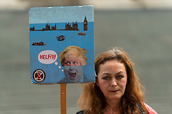 """© Licensed to London News Pictures. 03/09/2021. LONDON, UK.  A climate activist from Extinction Rebellion with a sign ahead of a protest march from St Paul's Cathedral to the Lloyds Building in the City of London to highlight the complicity of the financial industry on climate change.  The event takes place on day twelve of the two week 'Impossible Rebellion' protest to """"target the root cause of the climate and ecological crisis"""".  Photo credit: Stephen Chung/LNP"""