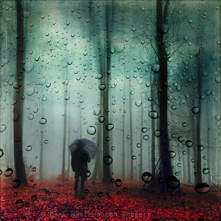 Abstract forest scenery with a man with umbrella and water drops overlay