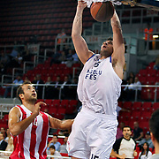 Anadolu Efes's Estaban BATISTA (R) during their Two Nations Cup basketball match Anadolu Efes between Olympiacos at Abdi Ipekci Arena in Istanbul Turkey on Sunday 02 October 2011. Photo by TURKPIX