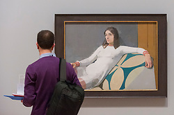 """© Licensed to London News Pictures. 26/02/2018. LONDON, UK. A visitor views """"Georgia"""", 1973, by Euan Uglow.  Preview of """"All Too Human"""", an exhibition at Tate Britain which explores how artists in Britain have stretched the possibilities of paint in order to capture life around them.  The exhibition runs 28 February to 27 August 2018 and includes rarely seen works by Lucian Freud and Francis Bacon.  Photo credit: Stephen Chung/LNP"""